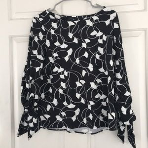 Ann Taylor black top with ginkgo print.